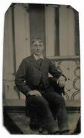 Tintype Photograph Young Man Seated Photographer's Chair Painted Backdrop