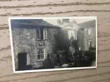 More details for fire at embsay fish shop,skipton,fire engine ,firemen in building up ladder,1920