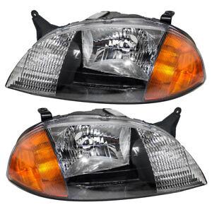 Headlights Set fits 1998-2001 Chevy Metro Suzuki Swift Pair Headlamps w/ Housing