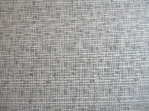 ROLL END OF 4.3 METRES OF A TEXTURED WEAVE UPHOLSTERY FABRIC IN CHARCOAL GREY