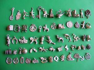 A) VINTAGE STERLING SILVER CHARMS CHARM HORSE CHERUB TAXI WITCH RINGS PIG YACHT