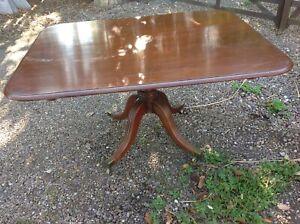 Georgian pedestal tilt top mahogany dining table