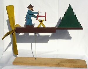 Nicely painted, contructed, old folk art whirligig of a bearded man sawing wood.