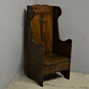Small solid oak settle monks chair with heart delivery available