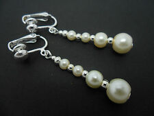 A PAIR OF DANGLY IVORY GLASS PEARL  SILVER PLATED CLIP ON   EARRINGS.