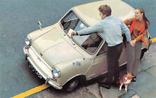 R103009 Car. Woman. Man. Dog. 1969
