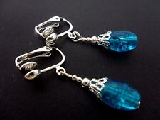 A PAIR OF PRETTY BLUE OVAL CRACKLE GLASS BEAD  CLIP ON EARRINGS. NEW.