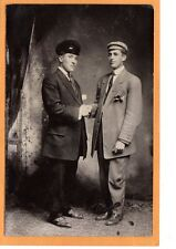 Real photo postcard RPPC-zwei Männer Händedruck Bellinger Foto Lakefield MN