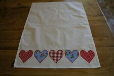 Handmade shabby chic decorated tea towel with red blue strawberry hearts