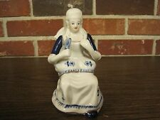 VINTAGE CERAMIC / PORCELAIN BLUE AND WHITE LADY FIGURINE SITTING IN A CHAIR