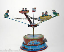 TIN TOY SPACE ROCKET FAIRGROUND MERRY GO ROUND AUTOMATIC SPINNING ACTION COLLECT
