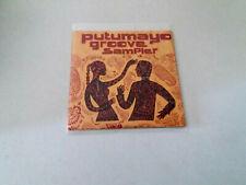 "CD ""PUTUMAYO GROOVE SAMPLER"" CD 10 TRACKS CARDBOARD"