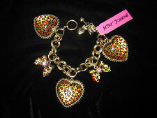 BETSEY JOHNSON LEOPARD HEART WITH BOW AND PINK STONES BRACELET