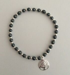 Sterling Silver And Hematite Stretch Bracelet & Sterling Tree Of Life Charm.
