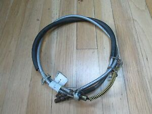 """NOS 1984 FORD TEMPO REAR PARKING BRAKE CABLE 60"""""""