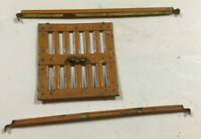 A standard gauge Lionel stock car door and guides