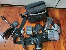 Canon Powershot SX40 HS zoom lens 35x is 4.3-150.5mm. Includes case, tripod, etc