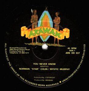 "NORMAN 'star' COLLINS & MYSTIC M-you never know    arawak 12""   (hear)    reggae"