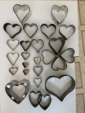 Lot of 24 vintage metal/tin heart shaped cookie cutters, varying sizes