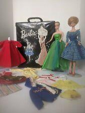 New ListingVintage Barbie's , case & clothes