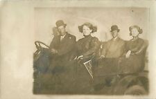 Two Couples In Make Believe Auto, Gibson Corn Carnival, Gibson City  IL RPPC