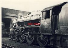 PHOTO  BLACK 5 45342 CATCHES THE SUN OUTSIDE CARNFORTH SHED  APRIL 68.  SOME OF