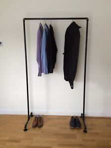 Industrial clothing shelf made from galvanised iron in black.