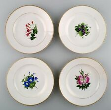 4 antique Royal Copenhagen flat plates in flora danica style.