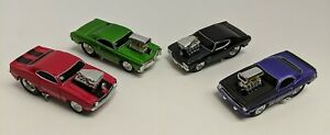 (4) Muscle Machines '66 PontiacGTO, '69 Camaro, '69 Chevelle, '70 Cuda 1:64 2000