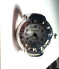 NOVELTY WATCH RING WITH ROMAN NUMERAL BORDER