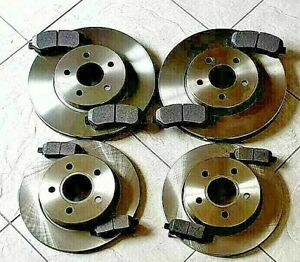 FOR NISSAN JUKE 1.6 10-14 TWO FRONT & TWO REAR BRAKE DISCS AND BRAKE PADS