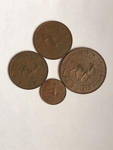 Qatar and Dubai coins