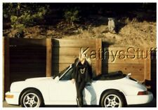 COLOR PHOTO I_9614 PRETTY WOMAN SITTING ON SIDE OF CONVERTIBLE