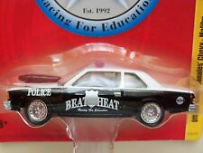 JOHNNY LIGHTNING - BEAT THE HEAT - OFFICER HENRY CANALES' CHEVY MALIBU DRAG CAR