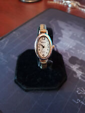 ladies ravel silver & gold tone dress watch,white easy to see dial oval case.b2.