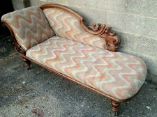 Antique  Chaise Longue With Ornately Carved Wooden Frame On Brass Castors