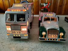 HESS TRUCKS 2002 and 2003.with working lights, and boxes. Collectible