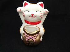 Ceramic White Waving Cat Moneybox with Orange Stripes.