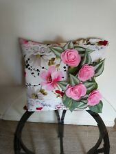 Decor pillows with pink roses and leaves that were sew by hand.