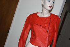 bebe Cropped seamed orange color leatherette jacket size XS