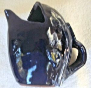 2015Whale pottery pitcher navy blue/white splashes  approx 7high/8.5 wide signed