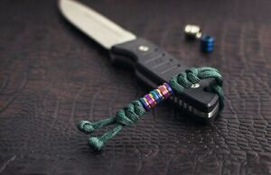 Reflective paracord lanyard, Zeus Emerald green.  With two small titanium beads