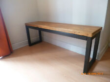 Hand made bench in reclaimed spruce and powder coated steel frames