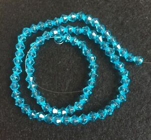 4mm Blue glass crystal faceted bicone beads approx 12in strand