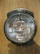 Harley Davidson Ironhead Shovelhead headlight bucket, lens and chrome cover.