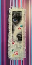 Completed Cross Stitch Bookmark - Black & White Dog With Multi-Color Pawprints