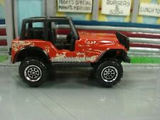 Matchbox Jeep CJ-7 4X4 in red that is loose from a Top Gun Maverick Multi-Pack