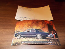 1965 Oldsmobile F85 Deluxe 4-Door Sedan Advertising Postcard