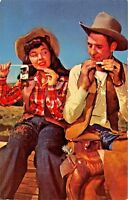 COWGIRL & COWBOY-RIDE EM AND ROLL EM- CIGARETTE SMOKING POSTCARD 1960s
