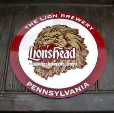 """THE LION BREWERY 17"""" DIA TIN SIGN."""